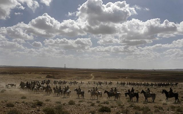 Members of the Australian Light Horse association ride towards Beer-Sheva in the northern Israeli desert on October 30, 2017 during a reenactment of the historical fight of the ANZAC (Australian and New Zealand Mounted Division) where forces captured the area from the Ottoman Empire during the First World War. (AFP PHOTO / MENAHEM KAHANA)