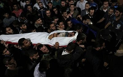 The body of Marwan Alagha, 22, is carried by mourners after he was killed when Israel blew up a tunnel built by the Islamic Jihad terror group stretching from the Gaza Strip into its territory, at Naser hospital in Khan Yunis, in the southern Gaza Strip, on October 30, 2017.  (SAID KHATIB / AFP)