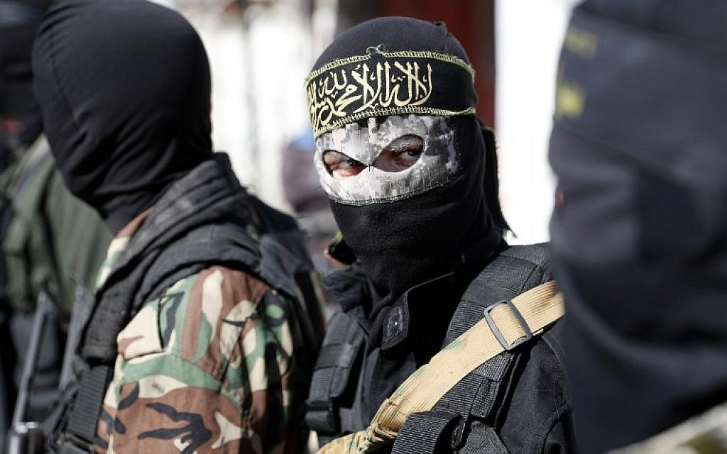 Illustrative: Members of the Palestinian Islamic Jihad terror group attend the funeral of fellow terrorists killed in an Israeli operation to blow up a tunnel stretching from the Gaza Strip into Israel in central Gaza, on October 31, 2017. (AFP/Thomas Coex)