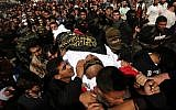 Mourners carry the coffin of Palestinian Islamic Jihad Movement terrorist Arafat Abu Morshed during the funeral at the Bureij refugee camp, in central Gaza of Palestinians killed in an Israeli operation to blow up a tunnel stretching from the Gaza Strip into Israel, on October 31, 2017. (Mahmud Hams/AFP)