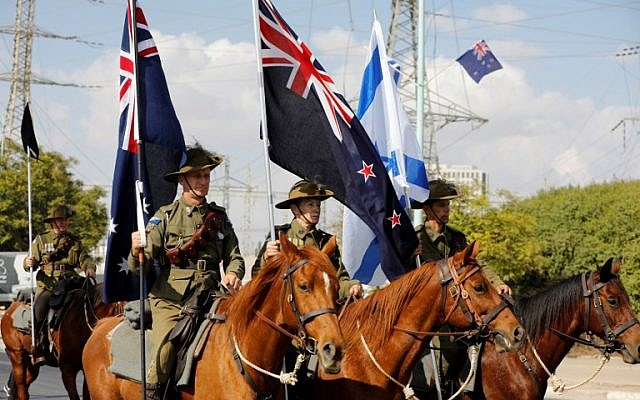 Members of the Australian Light Horse association ride through Beersheba, in the northern Israeli desert, on October 31, 2017, ahead of a reenactment of the historical fight of the ANZAC (Australian and New Zealand Mounted Division) where forces captured the city from the Ottoman Empire during the First World War. (AFP PHOTO / Menahem KAHANA)