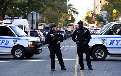 File: NYPD officers in New York on October 31, 2017. (AFP Photo/Don Emmert)