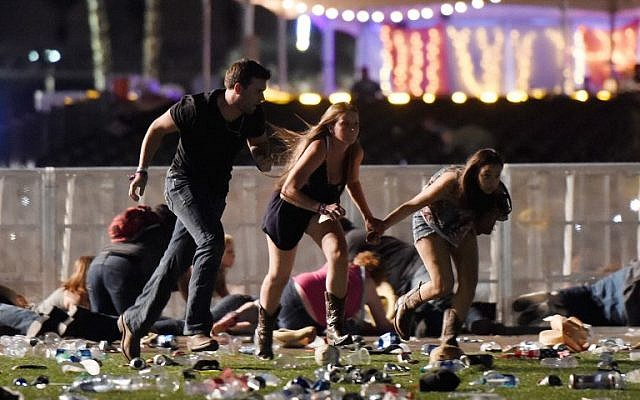 People run from the Route 91 Harvest country music festival after apparent gun fire was heard in Las Vegas, Nevada, October 1, 2017. (David Becker/Getty Images/AFP)