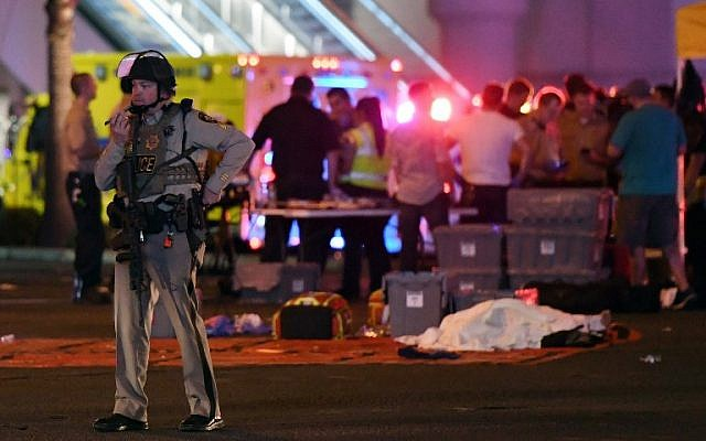 A Las Vegas Metropolitan Police officer stands in the intersection of Las Vegas Boulevard and Tropicana Ave. after a mass shooting at a country music festival nearby on October 2, 2017, in Las Vegas, Nevada. (Ethan Miller/Getty Images/AFP)