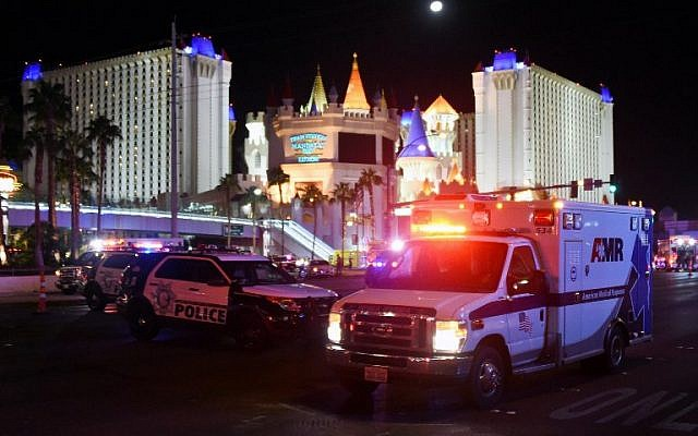 An ambulance leaves the intersection of Las Vegas Boulevard and Tropicana Avenue after a mass shooting at a country music festival nearby on October 2, 2017, in Las Vegas, Nevada. (Ethan Miller/Getty Images/AFP)