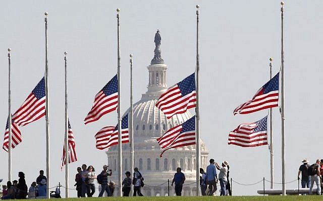 American flags on the grounds of the Washington Monument are flown at half-mast on October 2, 2017, after US President Donald Trump ordered the flags on all federal buildings to fly at half-mast following the mass shooting that left more than 50 dead in Las Vegas. (Mark Wilson/Getty Images/AFP)