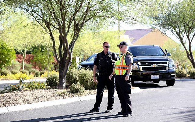 A Mesquite Police Department officer and volunteer block access to the Sun City Mesquite community where Las Vegas gunman Stephen Padock lived, on October 2, 2017, in Mesquite, Nevada. (Gabe Ginsberg/Getty Images/AFP)