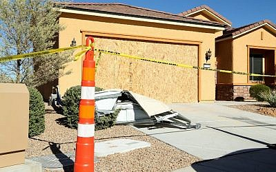 Remains of the garage door sit in the driveway of the house in the Sun City Mesquite community where Las Vegas gunman Stephen Paddock lived, on October 2, 2017, in Mesquite, Nevada. (Gabe Ginsberg/Getty Images/AFP)