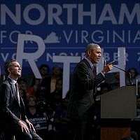 Former US President Barack Obama, right, speaks as he campaigns for Democratic gubernatorial candidate and Virginia Lieutenant Governor Ralph Northam during a campaign event at the Greater Richmond Convention Center October 19, 2017 in Richmond, Virginia. (Alex Wong/Getty Images/AFP)