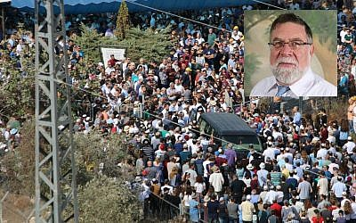 Mourners attend the funeral of Reuben Schmerling (inset) in the West Bank settlement of Elkana on October 6, 2017. (Dani Sitron)