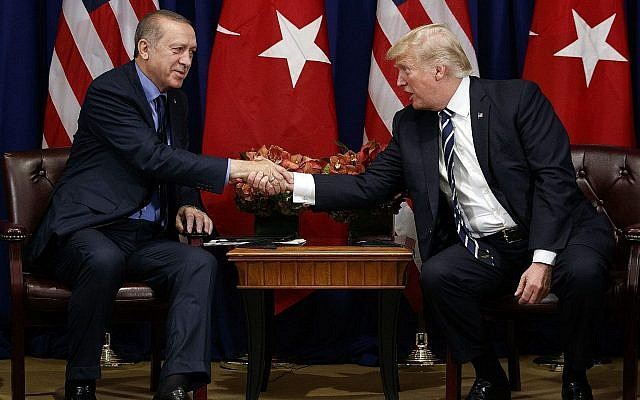 US President Donald Trump, right, shakes hands with Turkish President Recep Tayyip Erdogan during a meeting at the Palace Hotel during the United Nations General Assembly, September 21, 2017, in New York. (AP Photo/ Evan Vucci)