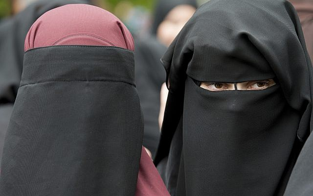 Illustrative: In this file photo from June 28, 2014, veiled women attend a speech by preacher Pierre Vogel, in Offenbach, near Frankfurt, Germany. (Boris Roessler/dpa via AP,file)