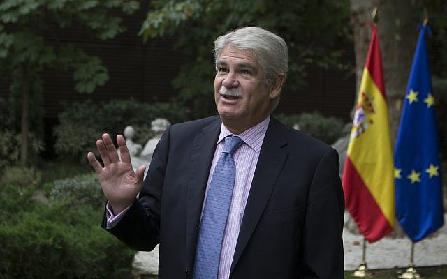 Spain's Foreign Minister Alfonso Dastis talks before an interview with The Associated Press about the Catalonia's referendum at the Foreign Ministry in Madrid, Spain, Saturday, Sept. 30, 2017 (AP Photo/Paul White)