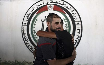 A Palestinian Fatah member receives greetings, after being released from a Hamas jail in front of the interior ministry, in Gaza City, October 1, 2017. (AP Photo/Khalil Hamra)