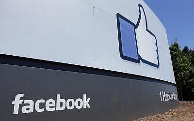 File: This July 16, 2013, photo shows a sign at Facebook headquarters in Menlo Park, California. (AP Photo/Ben Margot, File)
