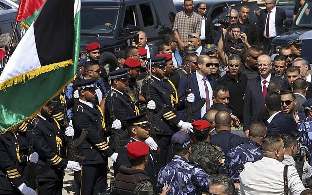 Palestinian Authority Prime Minister Rami Hamdallah reviews an honor guard on his arrival to the Palestinian side of the Beit Hanoun border crossing in the northern Gaza Strip, October 2, 2017. (AP Photo/Adel Hana)