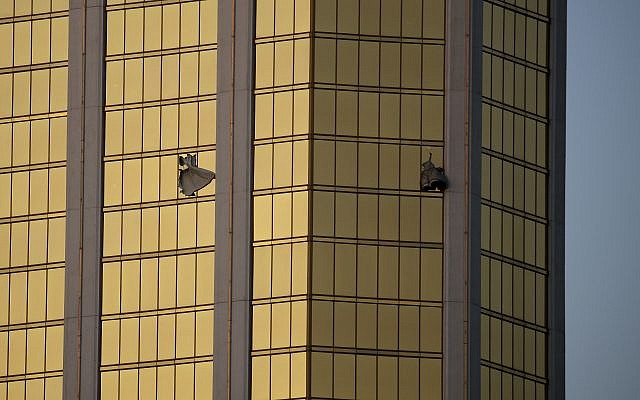 Drapes billow out of broken windows at the Mandalay Bay resort and casino on the Las Vegas Strip, October 2, 2017(AP/John Locher)