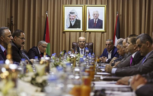 Palestinian Prime Minister Rami Hamdallah, center, chairs a reconciliation government cabinet meeting in Gaza City, October 3, 2017. (Mohammed Abed/Pool Photo via AP)