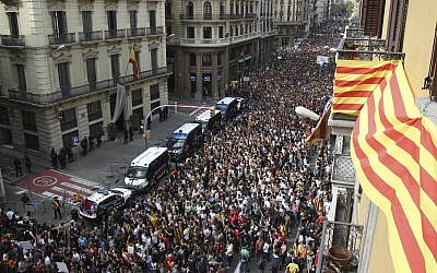 Protesters gather outside National Police Headquarters during a one-day strike in Barcelona, Spain, October 3, 2017. (AP/Bob Edme)