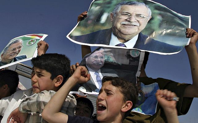 In this April 6, 2005 file photo, Kurdish youngsters celebrate the election of then Iraqi President Jalal Talabani, in downtown Sulaimaniyah, Iraq. (AP/Sasa Kralj, File)