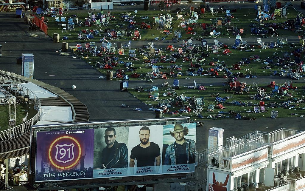 Debris litters a festival grounds across the street from the Mandalay Bay resort and casino Tuesday, Oct. 3, 2017, in Las Vegas. (AP Photo/Marcio Jose Sanchez)