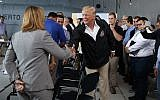 US President Donald Trump shakes hands with San Juan Mayor Carmen Yulin Cruz during a briefing on hurricane recovery efforts with first responders at Luis Muniz Air National Guard Base, Tuesday, October 3, 2017, in San Juan, Puerto Rico. (AP Photo/Evan Vucci)