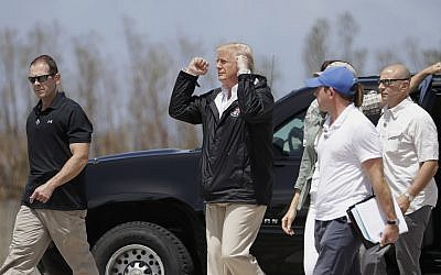US President Donald Trump gestures after arriving at the Luis Muñiz Air National Guard Base in San Juan, Puerto Rico, Tuesday, October 3, 2017. (AP Photo/Evan Vucci)