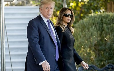 President Donald Trump and first lady Melania Trump walk toward Marine One on the South Lawn of the White House in Washington, Wednesday, Oct. 4, 2017, for a short trip to Andrews Air Force Base, Md., and then on to Las Vegas to visit with victims and first responders affected by the worst mass shooting in American history. (AP/Andrew Harnik)