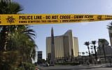 Part of Reno Ave. near South Las Vegas Blvd is blocked with police tape in the aftermath of a mass shooting Wednesday, Oct. 4, 2017, in Las Vegas. (AP/Marcio Jose Sanchez)