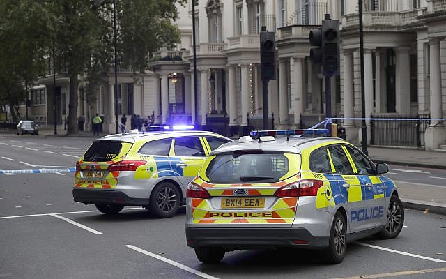 Britain's police cars at the scene of an incident in central London, Saturday, Oct. 7, 2017. London police say emergency services are outside the Natural History Museum in London after a car struck pedestrians. (AP/Kirsty Wigglesworth)