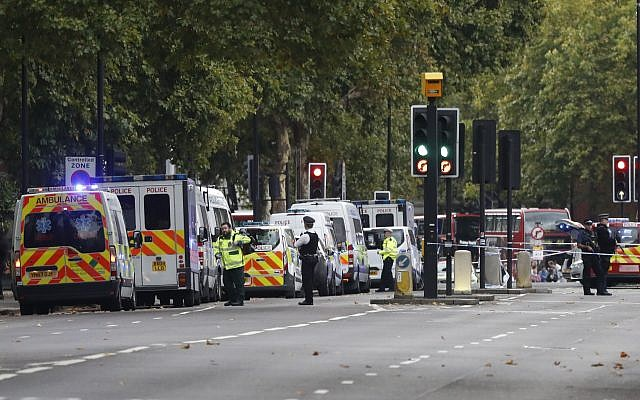 Britain's police and emergency services at the scene of an incident in central London, Saturday, Oct. 7, 2017. London police say emergency services are outside the Natural History Museum in London after a car struck pedestrians. (AP/Kirsty Wigglesworth)