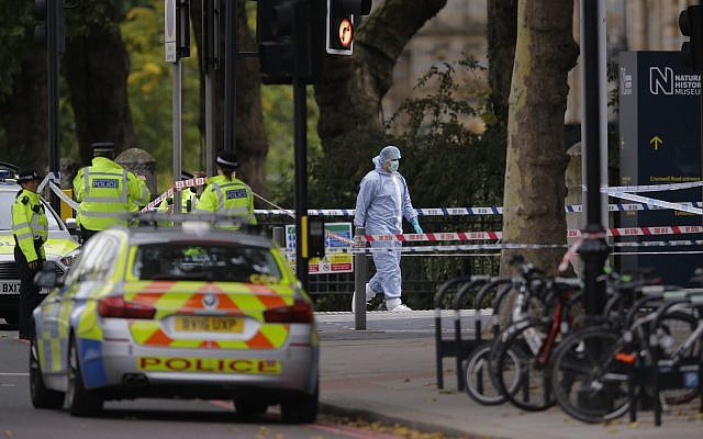 Britain's Police and a forensic investigator at the scene of an incident in central London, Saturday, Oct. 7, 2017. London police say emergency services are outside the Natural History Museum in London after a car struck pedestrians. (AP/Alastair Grant)