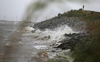Gulf Coast waves crash against rocks as winds continue to speed up in Coden, Alabama, on Saturday, October 7, 2017, ahead of Hurricane Nate. (AP/Brynn Anderson)