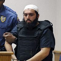 In this photo from Tuesday, Dec. 20, 2016, Ahmad Khan Rahimi, the man accused of setting off bombs in New Jersey and New York in September is led into court in Elizabeth, N.J. (AP/Mel Evans)