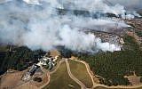 Smoke rises as a wildfire burns near Kenzo Estate in Napa, California, October 9, 2017. (Michael Short/San Francisco Chronicle via AP)