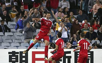 Syria's Omar Al Somah, left, jumps up after scoring against Australia during their Soccer World Cup qualifying match in Sydney, Australia, October 10, 2017. (AP Photo/Rick Rycroft)