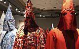 """KKK robes on display as part of Baltimore artist Paul Rucker's installation entitled """"Rewind,"""" September 21, 2017. (Ivey DeJesus/PennLive.com via AP)"""
