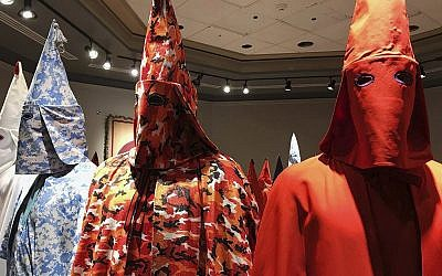 "KKK robes on display as part of Baltimore artist Paul Rucker's installation entitled ""Rewind,"" September 21, 2017. (Ivey DeJesus/PennLive.com via AP)"