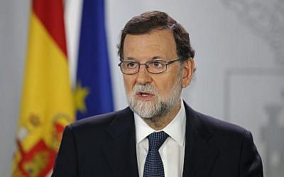 Spain's Prime Minister Mariano Rajoy speaks during a press conference at the Moncloa Palace in Madrid, Spain, Wednesday, Oct. 11, 2017. (AP Photo/Paul White)