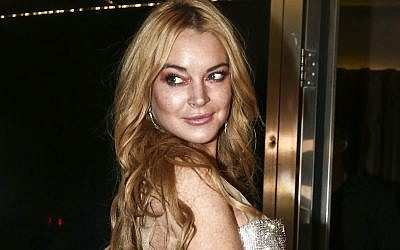 In this Oct. 16, 2016, file photo, actress Lindsay Lohan appears at the opening night of the Lohan Nightclub in Athens, Greece. (AP Photo/Yorgos Karahalis, File)