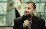 Hamas representative Saleh al-Arouri speaks after signing a reconciliation deal with senior Fatah official Azzam al-Ahmad, during a short ceremony at the Egyptian intelligence complex in Cairo, Egypt, Thursday, Oct. 12, 2017. (AP/Nariman El-Mofty)