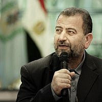 Hamas deputy political chief Saleh al-Arouri, after signing a reconciliation deal with senior Fatah official Azzam al-Ahmad, during a short ceremony at the Egyptian intelligence complex in Cairo, Egypt, October 12, 2017. (AP/Nariman El-Mofty)