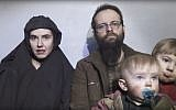 In this image from video released by Taliban Media in December 2016, Caitlan Coleman talks in the video while her Canadian husband Joshua Boyle holds their two children.   (Taliban Media via AP)