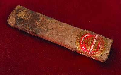 This auction item is a cigar once smoked by then-British prime minister Winston Churchill. Churchill's half-smoked cigar, from a 1947 trip to Paris, sold for just over $12,000 during an online auction. (RR Auction photo via AP)