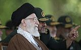 In this Wednesday, May 20, 2015 file picture released by the official website of the office of the Iranian supreme leader, Ayatollah Ali Khamenei listens to IRGC commander Mohammad Ali Jafari during a graduation ceremony of officers in Tehran, Iran. (Office of the Iranian Supreme Leader via AP, File)