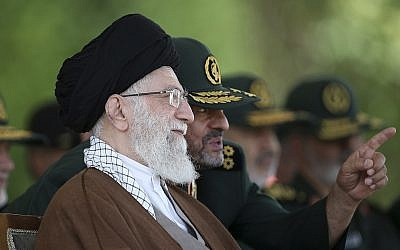 In this Wednesday, May 20, 2015 file picture released by the official website of the office of the Iranian supreme leader, Supreme Leader Ayatollah Ali Khamenei listens to IRGC commander Mohammad Ali Jafari during a graduation ceremony of a group of the guard's officers in Tehran, Iran (Office of the Iranian Supreme Leader via AP, File)