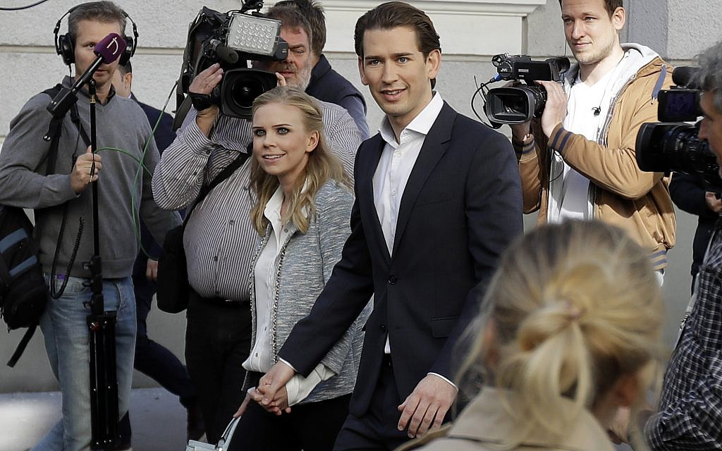 Foreign Minister Sebastian Kurz, head of Austrian People's Party, and his girlfriend Susanne Thier (L) leave the polling station after they cast their vote in Vienna, Austria, Sunday, October 15, 2017. (AP Photo/Matthias Schrader)