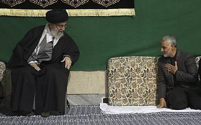Commander of Iran's Quds Force, Qassem Soleimani, right, greets Supreme Leader Ayatollah Ali Khamenei while attending a religious ceremony in a mosque at his residence in Tehran, Iran, March 27, 2015. (Office of the Iranian Supreme Leader via AP)