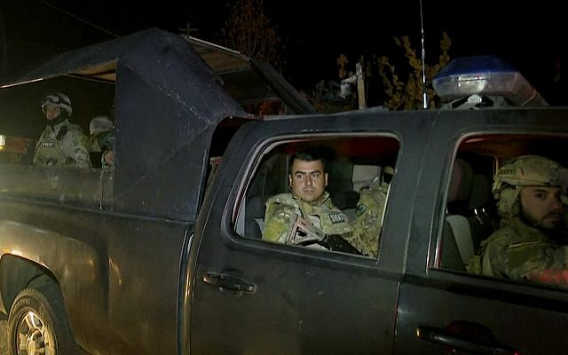 This image made from a video provided by RUDAW TV shows what the Irbil-based Kurdish broadcaster says are Peshmerga fighters and volunteers arriving on military trucks in Kirkuk, Iraq, October 16, 2017. (RUDAW TV via AP)