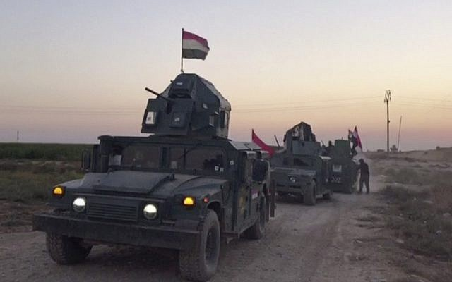 This image from a video shows Iraqi soldiers in military vehicles in the Qatash area moving towards a gas plant, south of Kirkuk, Iraq, October 16, 2017. (APTN via AP)